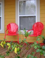 Front porch with red chairs