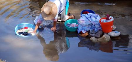 Women doing wash in stream