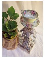 A shabby chic votive holder