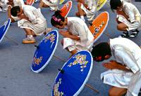 Bo Sang Umbrella parade showing traditional way of