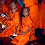 """Novice monks wear traditional costume during Poi S"" by jahenig"