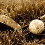 """Rough old gold club and ball sepia image"" by wingnutdesigns"