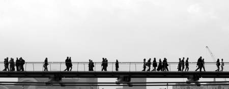 people crossing The Millennium Bridge