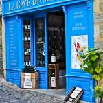"""""""Blue Bordeaux Wine shop, St. Emilion, France"""" by mjphoto-graphics"""