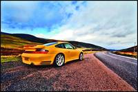 Porsche 911 in the Highlands (rear wide)