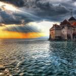 """The Sun Sets on Château de Chillon"" by PearBiter"