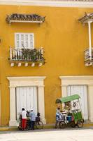 yellow building with vendors
