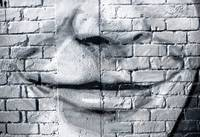 Graffiti face on the grunge wall