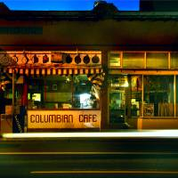 columbia cafe at night Art Prints & Posters by Jody Miller