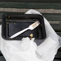 Plastic Container On A Bench In NYC Art Prints & Posters by Debbie Eynon Finley