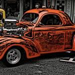 """IMG_4447_orange hot rod woodcut crop"" by pi"