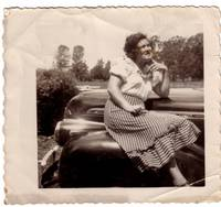 lorene (mamaw) posing on a car
