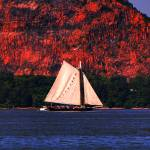 """Sailboat under red cliff"" by WeiZhang"