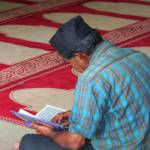 """Muslim Reading Quran"" by travelyn"