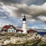 """Afternoon Clouds at Portland Head Lighthouse in Ma"" by digitalvisions"