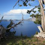 """Crater Lake with Tree Trunks"" by Groecar"
