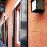 """New Orleans Orange Building"" by KerryFletcher"