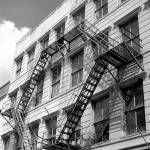 """New Orleans Fire Escape Black and White"" by KerryFletcher"