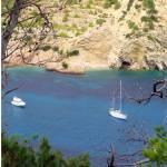 """Yachts in Cala Llonga Bay"" by TomGomez"