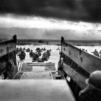 """Troops from the First Division landing on Omaha Be"" by WorldWide Archive"