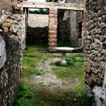 """Pompeii - Entrance to an ancient courtyard"" by arttraveler"