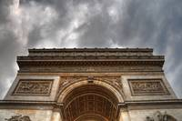 Arc de Triomphe under Ominous Clouds