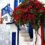 """White house with blue door  Mykonos, Greece"" by arttraveler"