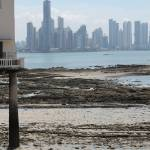 """Panama City. Two men, a beach and the skyscrappers"" by romain"
