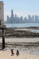Panama City. Two men, a beach and the skyscrappers