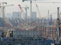 Olympic Stadium with Aquatics centre emerging in f