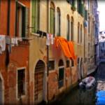 """Orange laundry on a Venetian canal"" by sylviacook"