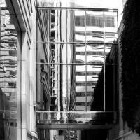 Between Buildings...Reflections - Black and White by Patricia Schnepf