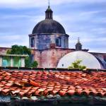 """Roof Tiles and Church"" by johncorney"