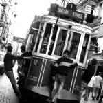 """Historic tram on Istiklal Avenue"" by OnayGencturk"