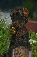 Hello bear statue with foliage