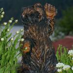 """welcome bear statue with daisies and bay in backgr"" by wildethangs"