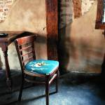 """Empty Chairs at Empty Tables"" by WadeGriffith"