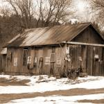 """old sephia barn with signs"" by jpt"