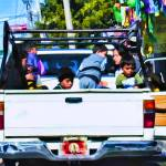 """Mexican Children in Back of Truck"" by johncorney"