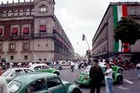 Green Taxis Looking out of the Zocalo