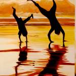 """Silhouette beach shadows at sunset Handstand buddi"" by Spangles44"