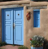 Blue door on adobe