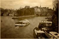 Paris and boats on the Seine River