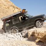 """Jeep on the rocks in the desert"" by sharonphoto"