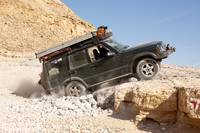 Jeep on the rocks in the desert