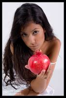 Girl giving red pomegranate