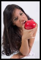 Girl eating red pomegranate