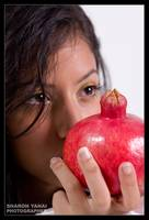 Girl holding red pomegranate