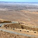 """Desert zig-zag road panorama"" by sharonphoto"