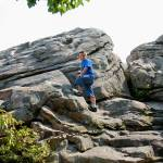 """boy climbing on rock"" by imagineit"